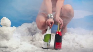 Young girl holds two bottles — Stock Video