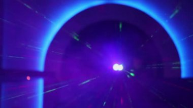 Laser emits rays under blue arch — Stock Video