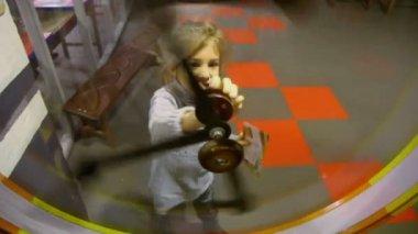 Little girl spins pendulum mechanism — Stock Video
