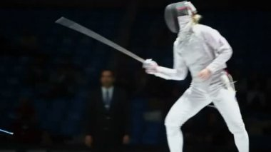 Duel of sportswomen on championship of fencing — Stock Video