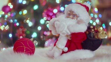 Toy Santa Claus near Christmas tree — Stock Video