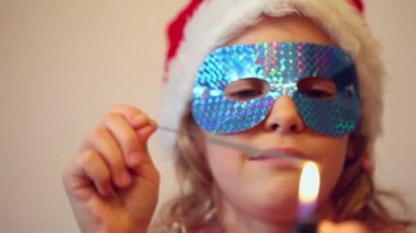 Little girl in holiday mask — Stock Video