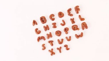 Alphabet letters from cereals — Vídeo stock