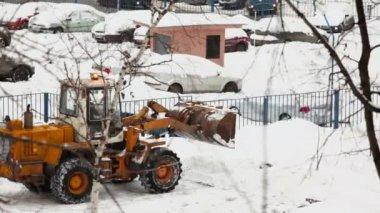 Bulldozer rides backward on parking — Stock Video