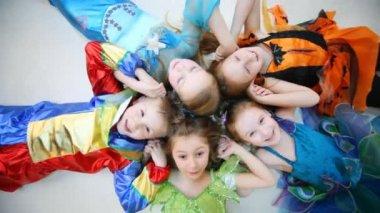 Children in costumes on floor — Stock Video