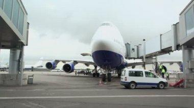 Passengers aircraft near terminal at airport — Stock Video