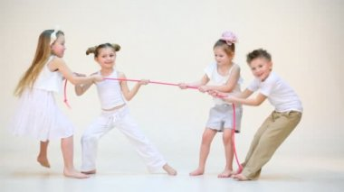 Four adorable children with pink rope — Video Stock
