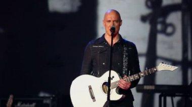 Denis Maidanov with guitar sings — Stock Video