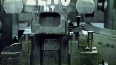 Man puts component under press machine — Stock Video