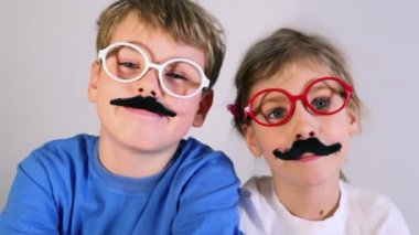 Two kids in toy glasses — Stock Video