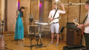 Four band members rehearsing — Stock Video