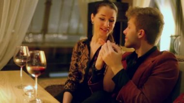 Couple talk and drink red wine — Stock Video