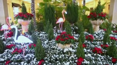 Artificial flamingos and palms with garland — Stok video