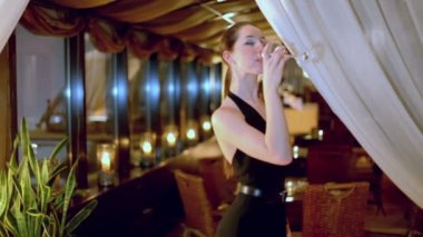 Young woman drinks wine — Stock Video