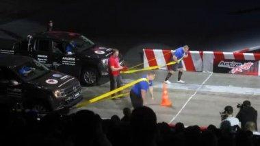 Man dragging cars at Festival — Stock Video
