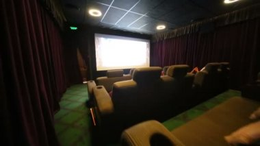 Soft sofas and screen in cinema — Stock Video