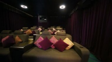 Soft sofas with projector in cinema — Stock Video