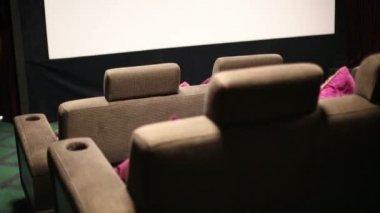 Soft sofa in cinema theatre — Stockvideo