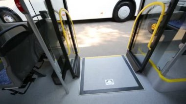 Closed wheelchair ramp in modern bus — Stockvideo