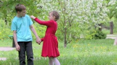 Girl in dress holds dandelion — Stock Video