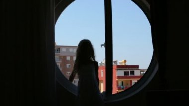 Girl sitting on window sill — Stock Video