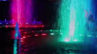 Colorful illumination flashes in fountain — Stock Video