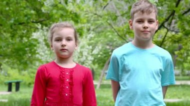 Boy and girl stand and smile — Stock Video