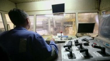 Worker operates with control units — Stock Video
