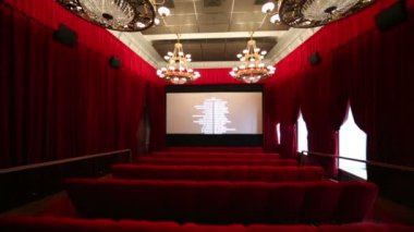 Big hall with red curtains in cinema — Wideo stockowe