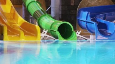 End of descent colorful water slides — Stock Video