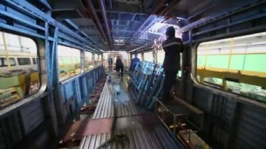 Workers weld inside wagon — Stock Video