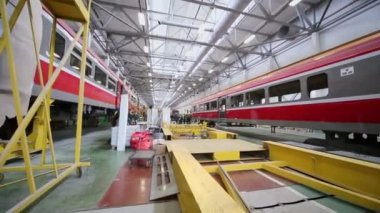 New trains at assemblage and journalists work — Stock Video