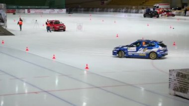 Blue race car rides by ice — Stock Video