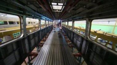 Workers weld inside dark train — Stock Video