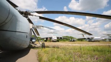 Helicopter and several airplanes on airfield. — Stock Video