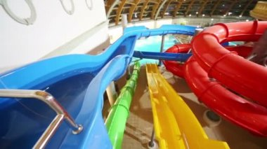 Colorful water slides at indoor waterpark — Stock Video