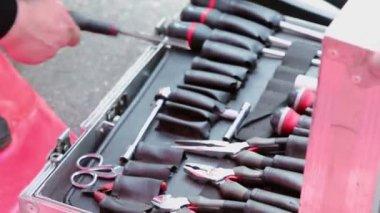 Automobile mechanic arranges tool kit — Video Stock