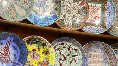 Colorful painted plates on shelf — Stock Video