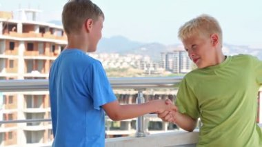 Two boys greet each other — Stock Video
