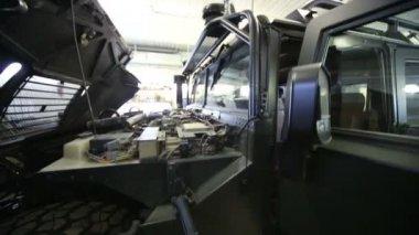 Large military car in repair shop — Stock Video