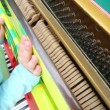 Children hands playing piano — Stock Video #70718279
