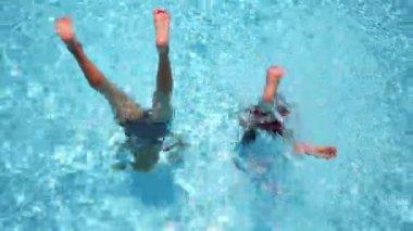 Two boys have fun in pool — Stock Video