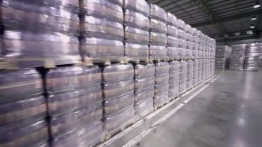 Lot of stacks with packaged beer in warehouse — Stock Video