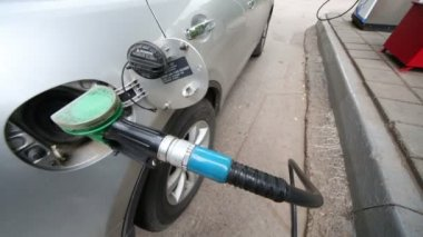 Silvery car refueling at gas station — Stock Video