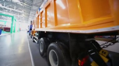 Orange dumper at International Specialized Exhibition — Stock Video