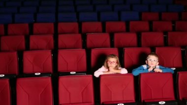 Boy and girl sitting in cinema — Stock Video