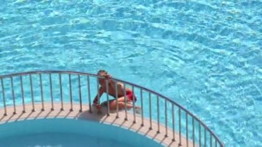 Little boy climbs out of pool — Stock Video
