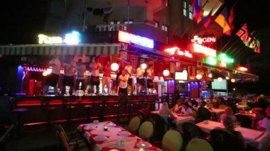 Barmen dance on bar counter at night — Stock Video