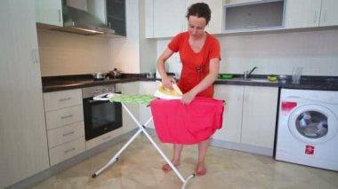 Beautiful barefoot housewife ironing laundry — Stockvideo