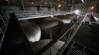 Many metal cisterns in dark workshop — Stock Video